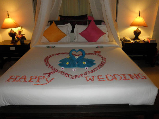 Flowers on bride and groom bed